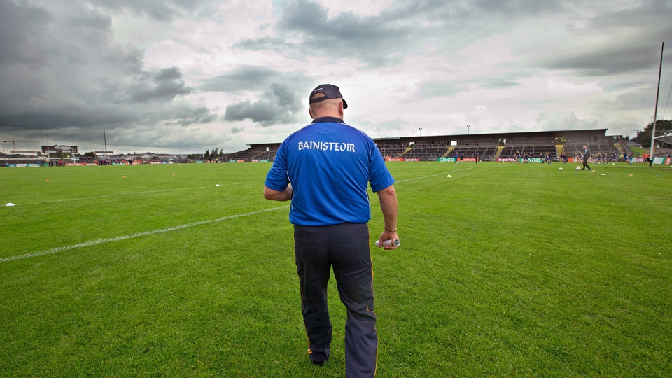 Roscommon manager John Evans on the pitch before the game against Armagh