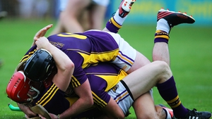 Wexford's Diarmuid O'Keeffe, Lee Chin and Eoin Moore celebrate after the final whistle