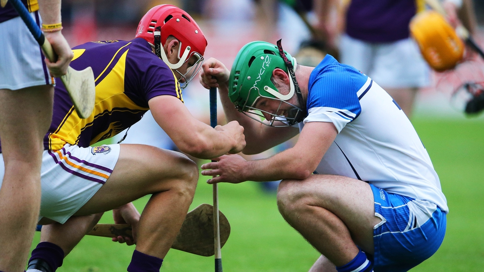 Class act: Wexford's Lee Chin consoles Gavin O'Brien of Waterford after the game