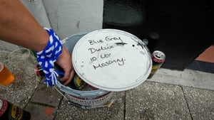 Fans find a novel way of keeping their drinks cool on the streets of Clones