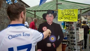 Back in Clones, Ciaran Morgan from Clones throws darts at a cardboard cutout of Garth Brooks at Clones
