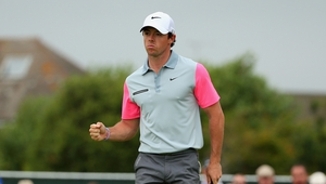 Rory McIlroy celebrates a birdie putt on the first hole of the final round of the Open Championship