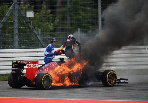 Daniil Kvyat of Scuderia Toro Rosso jumps out of his car after it caught fire during the German Grand Prix