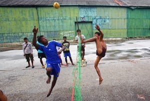 Men play Sepak Takraw, also known as Chinlone, in Burma