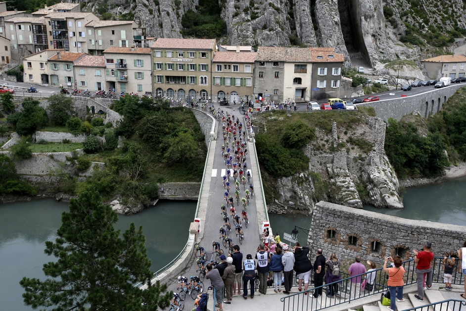 The peloton makes it way through Sisteron during the 15th stage of the 101st Tour de France