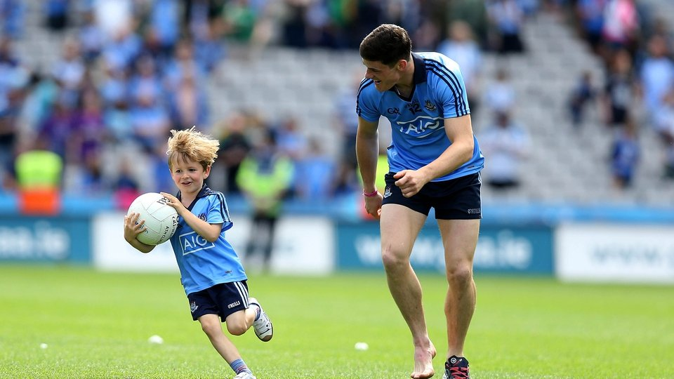 Alan Brogan's son Jamie plays with Diarmuid Connolly after the game