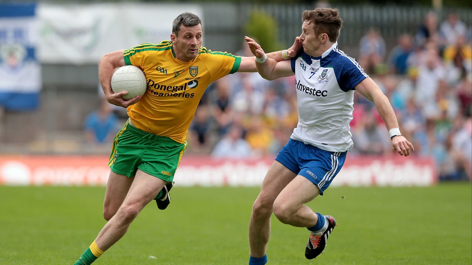 Christy Toye of Donegal holds off the challenge of Monaghan's Fintan Kelly
