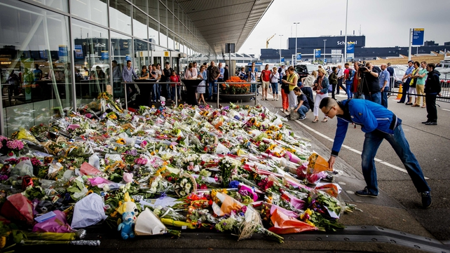 Floral tributes to the victims of the crash are placed outside Schiphol Airport in the Netherlands