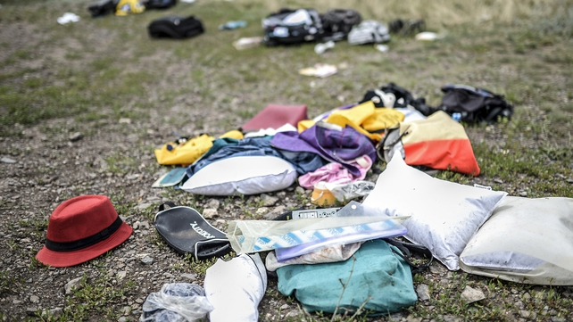 Personal belongings are scattered at the site of the crash in east Ukraine