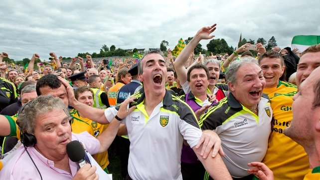 Donegal manager Jim McGuinness celebrates with players