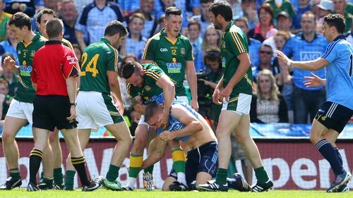 Meath's Mickey Burke tussles with Eoghan O'Gara