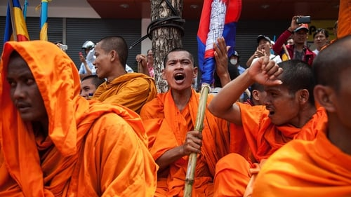 A Buddhist monk holding a Cambodian flag at a protest in Vietnam over the disputed Kampuchea Krom region