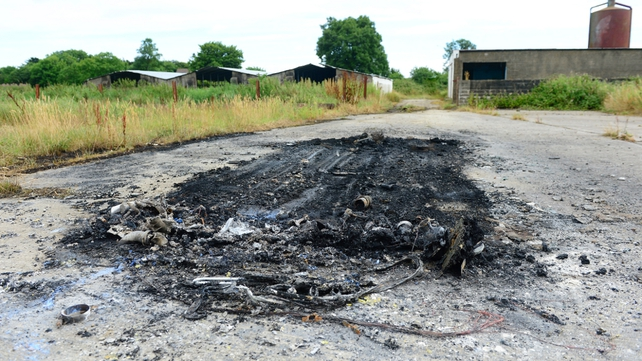 A car used by two masked men who abducted the teen was found burned out