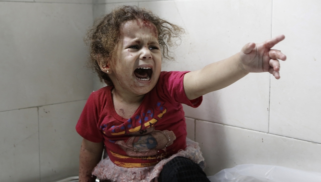 A Palestinian child shouts after Israeli forces shelled her house in Gaza City