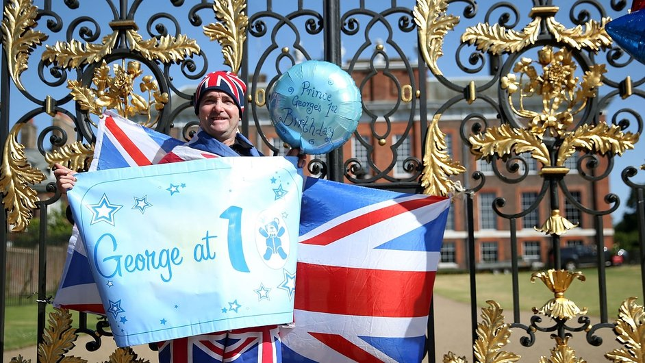 Well wishers place balloons and flags outside Kensington Palace as Prince George turns 1