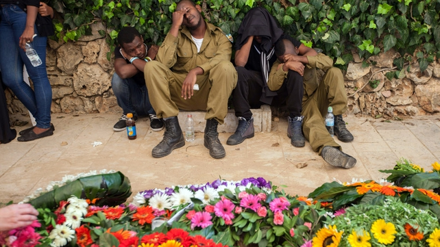 Family members and comrades of Israeli army Staff Sergeant Mosh Melako mourning at his funeral