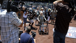105-year old Agnus McKee makes her way onto the field to throw out the ceremonial first pitch prior to start of the Major League baseball game between the San Diego Padres and the New York Mets