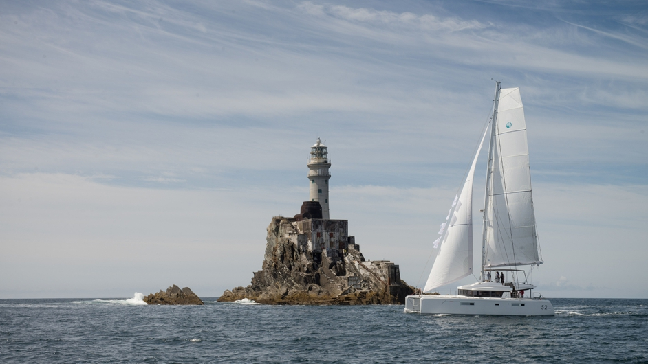A Lagoon 52 Catamaran rounding the Fastnet Rock on Saturday (Pic: Martin Salmon)