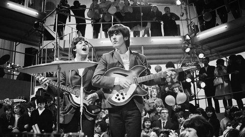 George Harrison (centre) with Paul McCartney