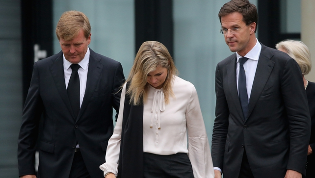 King Willem-Alexander, Queen Maxima and Dutch Prime Minister Mark Rutte (R) leave the Congresscentrum, Utrecht, after meeting relatives of the victims of Malaysia Airlines flight MH17