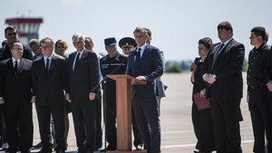 Hans Docter (C), Dutch Ambassador to Ukraine, speaks at the departure ceremony for the victims of the crash