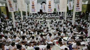 Hundreds of Indian students take part in a draw and drama competition as a part of a 'Save The Tiger' campaign in Kolkata