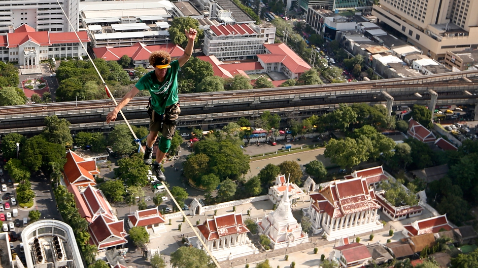 US slackliner Andy Lewis performs on a slackline across skyscrapers during a commercial promotion event in Bangkok, Thailand