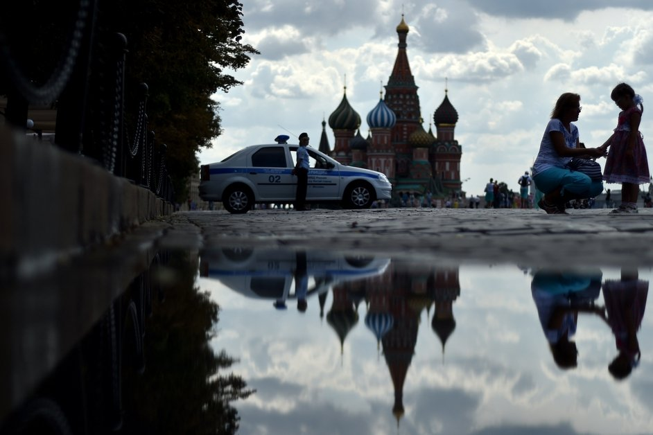 Moscow's landmark St Basil's Cathedral is reflected in a puddle at Red Square