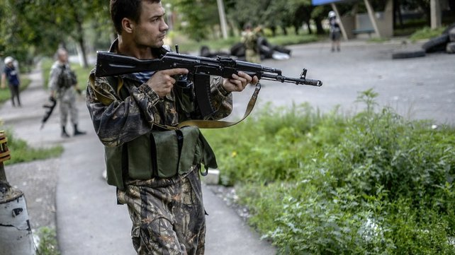A pro-Russia separatist near the front line in the northern outskirts of city of Donetsk