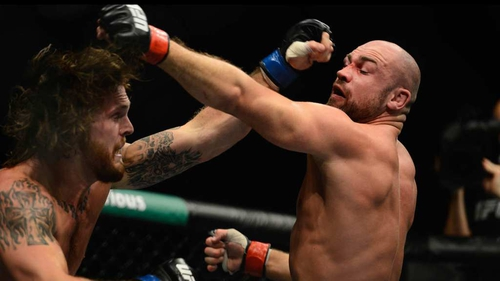 Mike King (left) in action against Cathal Pendred