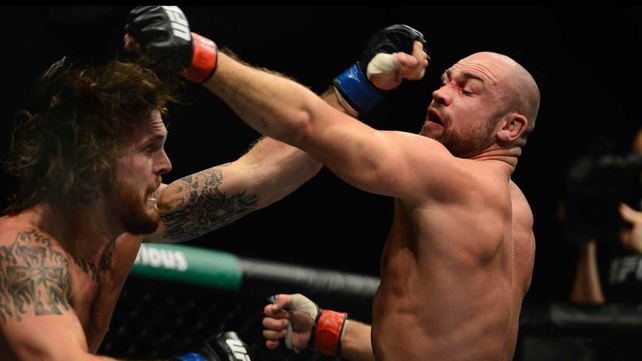 Cathal Pendred (right) and Mike King exchange blows