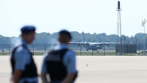 One of the military transport plane carrying the coffins lands at Eindhoven Airport