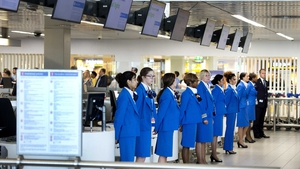 Stewardesses at Shiphol Airport observe a one-minute of silence in remembrance of the victims of the Malaysian Airlines MH17