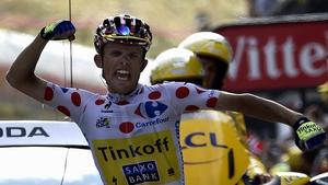 Rafal Majka roars in delight as he crosses the finish line