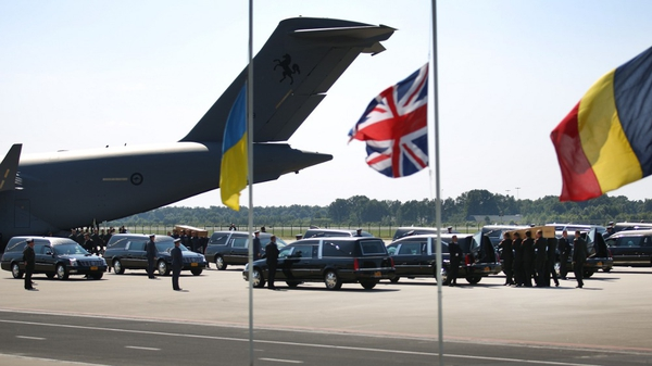Hearses line the runway at Eindhoven Airport as the bodies are brought to the Netherlands from Ukraine