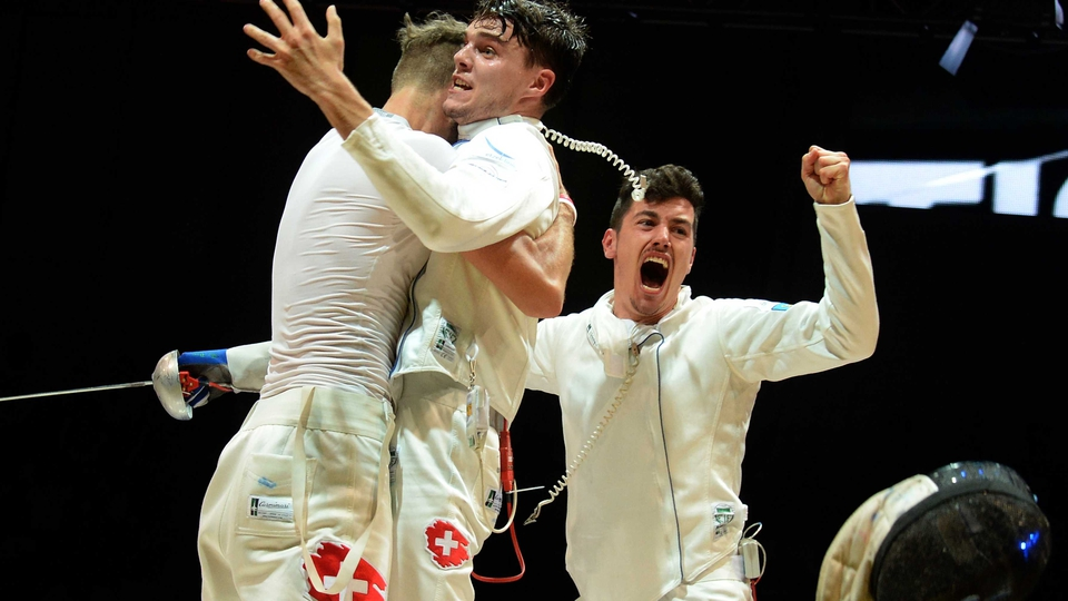 Members of Switzerland's team celebrate after winning the bronze medal during the team epee event at the 2014 World Fencing Championships in Kazan on Wednesday