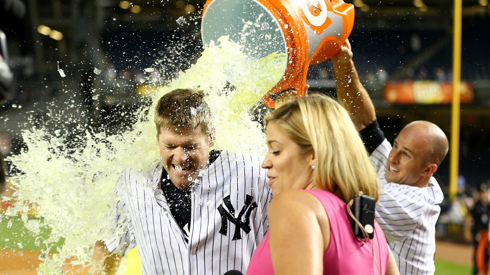 Chase Headley of the New York Yankees gets a Gatorade bath by team-mate Brett Gardner after the game against the Texas Rangers on Wednesday