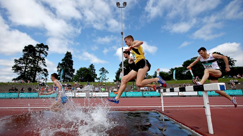 Competitors clear the water jump in the 3,000m steeplechase at the National Championships in in Santry