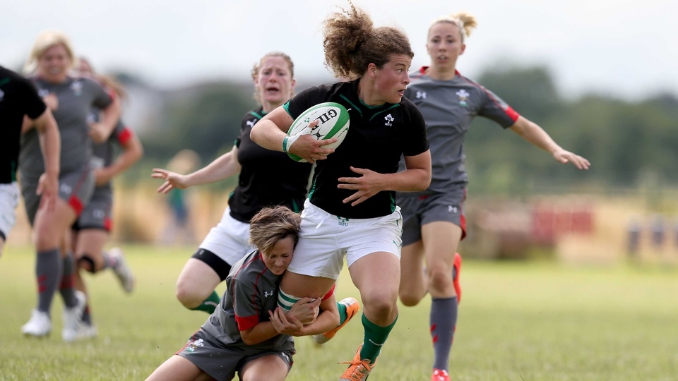 Ireland's Jenny Murphy tackled by Laurie Harries of Wales during an international friendly on Sunday