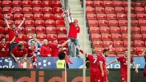 Danny North celebrates scoring Sligo's second goal against Rosenborg with fans on Thursday