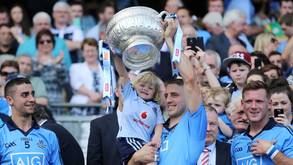 Eoghan O'Gara and his daughter Ella lift the Delaney Cup after the Leinster SFC final on Sunday