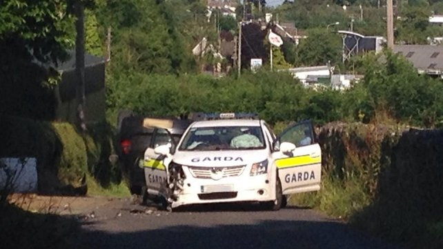 Garda car was on the driver's side by another car, which then overturned