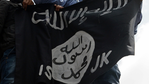 The flag of the Islamic State (IS), which is reported to have ordered female genital mutilation