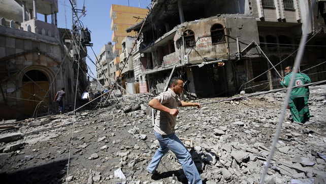 Palestinians inspect the destroyed al-Shamaa mosque after Israeli air strikes