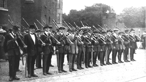 A group of Irish Volunteers stand with some of the rifles from the gun running (Pic: RTÉ Stills Library)
