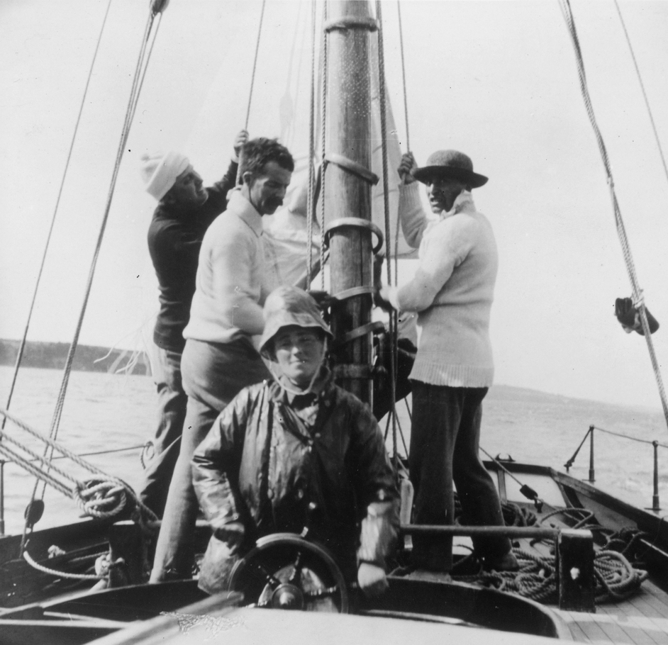 Molly Childers on board the Asgard with Erskine Childers (centre) in 1910