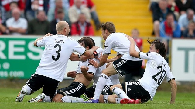 Rosenborg players celebrate Mike Jensen's goal at the Showgrounds