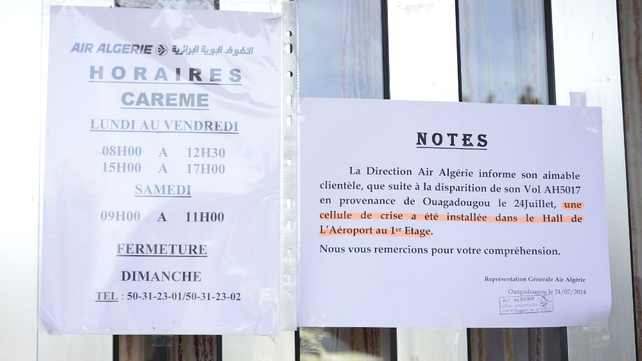 A note left on a door of an Air Algerie office, informing customers that a crisis centre has been set up following the crash