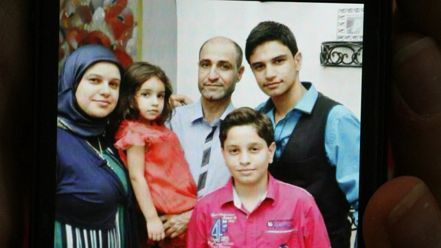 Picture on a mobile phone of relatives from the Daher family who were aboard the Air Algerie plane that crashed over Mali