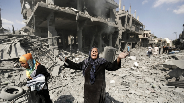 Women react to destroyed homes in the northern district of Beit Hanun in Gaza